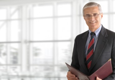 Mature Businessman Holding Folder
